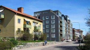 Fasadvy på förslaget från Hammarbygatan sett. Tanken är att det ska bli en siktpassage mellan husen genom att antalet våningar varierar från fem till sju. Illustration: Tovatt architects