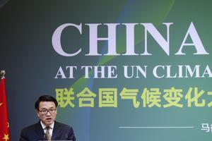 Vice ekologi- och miljöministern i Kina, Zhao Yingmin, talade på klimatmötet i Madrid. AP Photo/Manu Fernandez