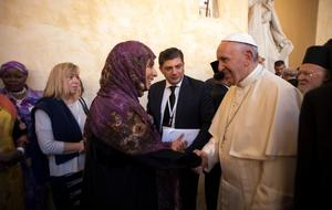 Pope Francis meets participants in a day of prayer for peace, in Assisi, Italy, Tuesday, Sept. 20, 2016. War refugees and leaders and representatives of several religions, including Christians, Jews, Muslims, Hindus and others, joined Pope Francis Tuesday in a day of prayer for peace in Assisi, the hometown of St. Francis, who preached tolerance and gentleness. (L'Osservatore Romano/Pool Photo via AP)