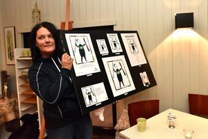 Maria Ljung visar alla platser där bilden kommer att användas.