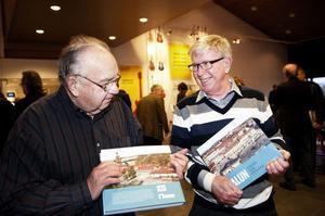 Två fotografer: Lars Anselius, som tagit omslagsbilden till boken, och Ragnar Andersson, som har med flest bilder.
