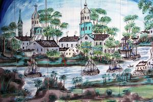 Detta är Gävle, som Blåmålarn från Dalarna skildrade staden. Motiv finns även hämtade från Stockholm, Haga slott, Västerås och Lappland i sängstugan vid Pallars.