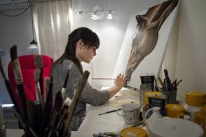 Rebecca Crosson vill bli så fotoidentisk som möjligt i sitt målande.
