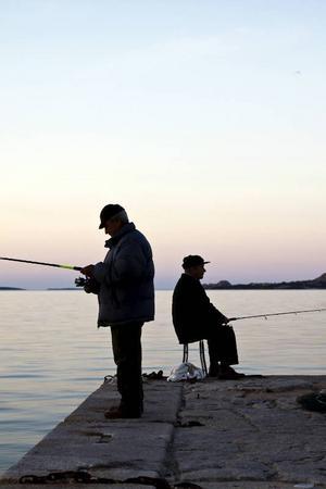 Fiskafänge i byn Cannigione på Sardinien.