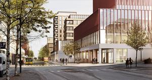 Busstorget sett från Kyrkgatan med ett nytt bibliotek närmast i bild. I bakgrunden syns en högre fastighet för bostäder.