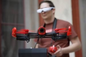 Parrot's pilot Maxime Tran Quan Tien guides his Bebop drone with remote glasses during a presentation to the press in Paris, France, Friday, Nov. 7, 2014. The new Parrot Bebop drone, a quadcopter type drone with a fish eye camera benefits from an exclusive 3-axes image stabilization system that maintains a fixed angle of the view, regardless of the inclination of the drone and its movements caused by wind turbulence. (AP Photo/Francois Mori)
