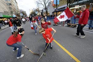 Kanadensiska fans i en match på asfalt i Vancouver under OS 2010.