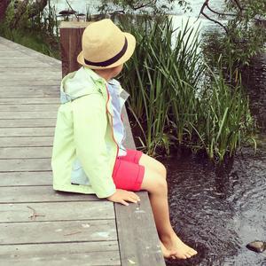 Här är min son vid ån i stan på första sommarlovsdagen! Han satt och njöt med fika och sol.