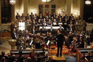 Norrtälje motettkör vid en tidigare konsert. Den 2 april framför kören John Rutters Magnificat.