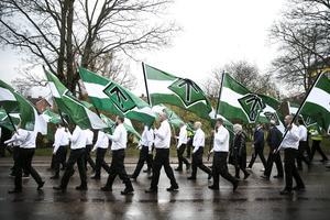 Nordiska motståndsrörelsen under en första maj-demonstration i Borlänge .