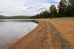 Härjeåsjön, Härjedalens riviera. En av många härliga stränder i Härjedalen som borde kunnas marknadsföras bättre.