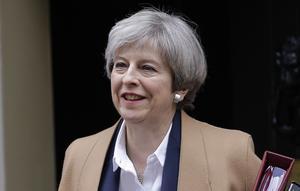 Storbritanniens premiärminister Theresa May llämnar 10 Downing Street på väg mot parlamentet på onsdagen.