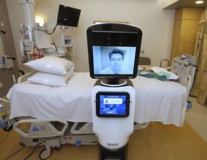 Läkarbesök vid sängen - men via en robot. Med hjälp av digital teknik, på bilden till exempel på Mercy San Juan Hospital i Carmichael i Kalifornien, kan läkare både ställa diagnoser och ge medicinska råd på distans.