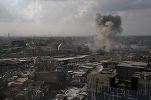 An rocket fired by Federal Police Rapid Response Forces explodes near the old city during fighting against Islamic State in Mosul, Iraq, Monday, March 20, 2017. (AP Photo/Felipe Dana)