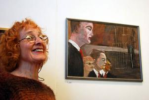 Inklämd mellan maktens män. I tavlan av Maud Olofsson med flera kommer Britt Jakobssons måleri verkligen fram.