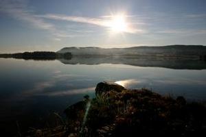 Tagen vid Ljusnans älvbrink, Förnebo, Järvsö.Tevesjön med Karsjö i bakgrunden.