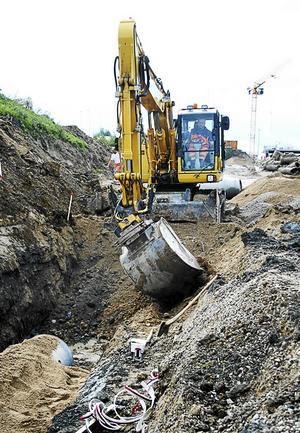 Engcon och företagets tiltrotator som gör skopan vridbar på grävmaskinen. Foto: Engcon Pressbild