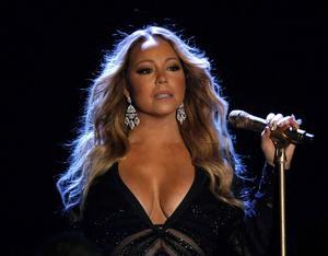 Mariah Carey har den populäraste låten i det gamla gardet, enligt Guardians sammanställning, men hon står sig slätt mot nya förmågor som Justin Bieber och Avicii. Arkivbild.   Foto: Claude Paris/AP/TT