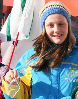 Med guldmedaljen efter segern i sprint i ungdoms-OS 2011.