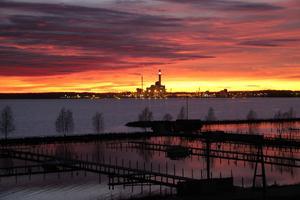 Solnedgång speglar sig i mälarens vatten  från Östermälarstrand.