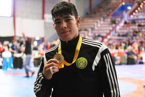 15-årige tog hem segern i klassen för ungdom 58kg.