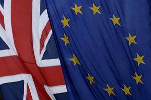 A European and British Union flags hang outside Europe House, the European Parliament's British offices, in London, Tuesday, March 14, 2017. (AP Photo/Matt Dunham)