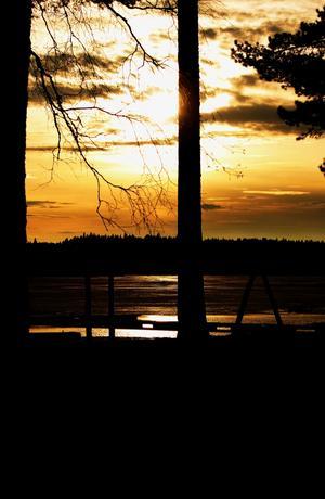 Solnedgång vid Guldkusten i Gimo, Uppland