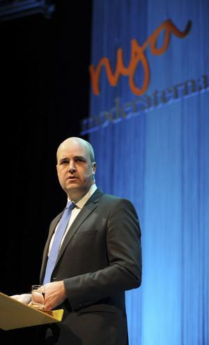 Han Som Bestämmer. Statsminister Fredrik Reinfeldt på Moderaternas partistämma, vars beslut om partibidrag bara gällde en dryg månad. Sedan bestämde partiledningen att acceptera lagstiftning om öppenhet.foto: scanpix