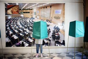 Sinnebilden av demokrati: allmänna val och en riksdag som är sammansatt enligt valresultatet.
