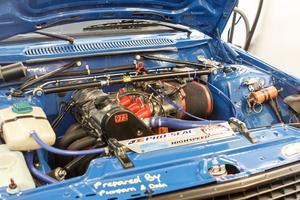 En titt under huven på parets tävlingsbil, en Volvo 240, avslöjar ett kraftigt modifierat innandöme.