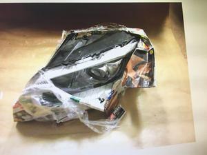 Flera stulna bildelar var inplastade och förberedda att återsändas till Litauen när polisen slog till. Här en inplastad strålkastare.