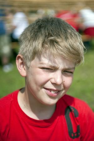 """Nils Petersson, 11 år, Mariestad:–Matteus 7:12, Den gyllene regeln, """" Allt vad ni vill att människorna skall göra för er, det skall ni också göra för dem""""."""