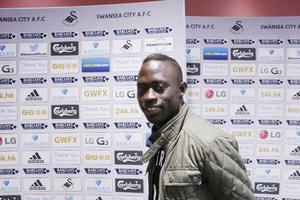 Modou Barrow får tränarberöm efter sin debut för Swansea.