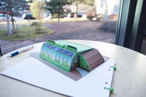 Eric Ficinus har konstruerat en byggsats för ett jordskepp i papp.