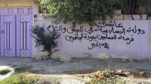 Mosul. Kristna har fått sina hem utmärkta av Isis.