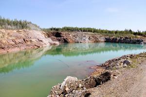 Dagbrottet är vattenfyllt och behöver tömmas innan gruvan kan tas i bruk igen.