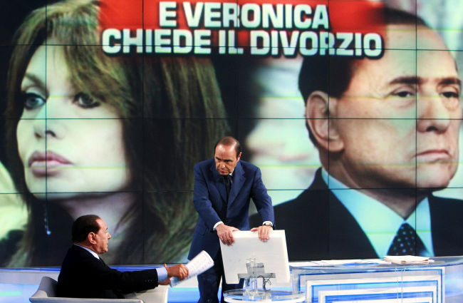 Berlusconi slass for att overleva