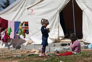 Syriska flyktingar i ett flyktingläger i Turkiet.