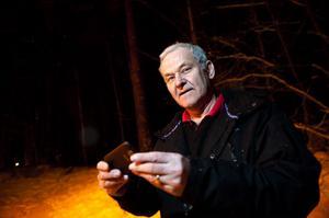 Lennart Logren filmade vargen med sin mobiltelefon.