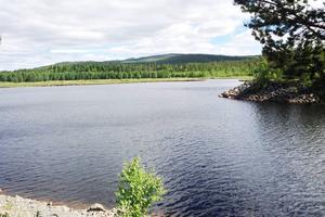 Mannen försvann när kanoten välte i Rändhån i Ljusnan, efter att vatten forsat ut genom utsläppet från Långå kraftverk.