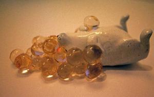 Sorkens söta drömmar – luftiga bubblor omger den sovande figuren.