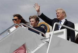 FILE - In this June 30, 2017 file photo, President Donald Trump, first lady Melania Trump and their son Barron Trump board Air Force One at Andrews Air Force Base, Md., en route to Trump National Golf Club in Bedminster, N.J. As President Donald Trump's administration alters some parts of the former first lady's legacy, Mrs. Trump is keeping other parts of it alive, from public policy to high fashion to family ties.  (AP Photo/Carolyn Kaster, File)
