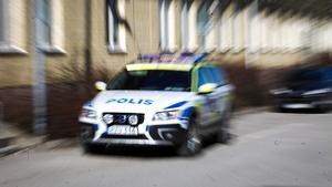 Polis, polisbil, blålljus, brott, polisman