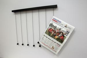 Tidningsupphängning.