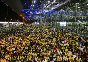 Anti government protesters sit in front of the departure terminal at Suvarnabhumi airport on Wednesday Nov. 26, 2008. The protesters  are demanding the resignation of Prime Minister Somchai Wongsawat.( AP Photo/Sakchai Lalit)