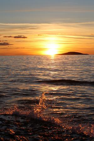 Solnedgång från Sandvik Byerum på norra Öland