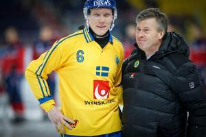 Lars Wennerholm bredvid Daniel Berlin under VM i Chabarovsk i februari.