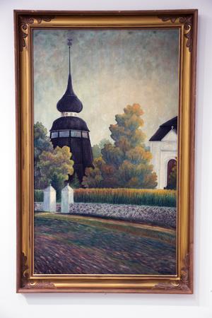 Klockstapeln och en del av Ovanåkers kyrka är motiven på denna tavla, som John Ondahl har i sin samling.