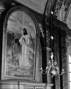 Altartavlan fick bara vara altartavla i ett 20-tal år, innan den hamnade på kyrkans långvägg.