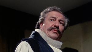 Rupert Davies spelar prästen John Lowes i